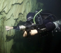 cave diving with torch
